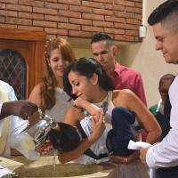 Photo of young people at the baptism of an infant.